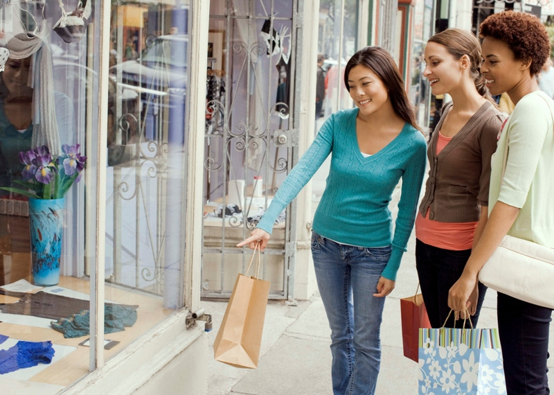 Friends window shopping, San Francisco, California